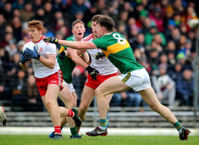 Kerry's Jack Barry tackling Pete Harte of Tyrone on Sunday.