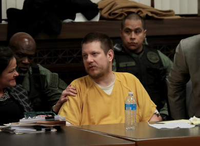 Former Chicago police officer Jason Van Dyke reacts with attorneys Tammy Wendt, left, and Daniel Herbert at Van Dyke's sentencing hearing.