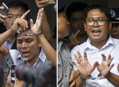 euters journalists Kyaw Soe Oo, left, and Wa Lone, are handcuffed as they are escorted by police out of the court last September.