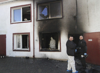 Forensic and other police experts examine the site of a fire in an Escape Room, in Koszalin, northern Poland, yesterday.