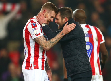 Stoke City manager Nathan Jones (right) celebrates at full time with James McClean.