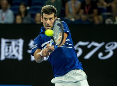 Novak Djokovic in action against Daniil Medvedev at the Australian Open today.