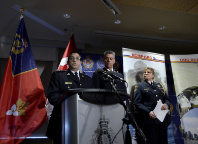 Officers answer questions from reporters after RCMP charged a youth with terrorism, in Kingston, Ontario