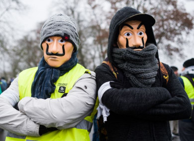 Two men wearing masks at a demonstration in Bourges today.
