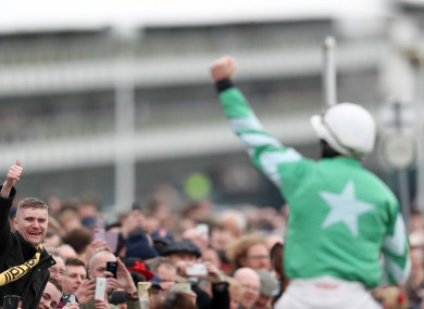 A racegoer salutes jockey Davy Russell on Presenting Percy after he won the RSA Insurance Novices' Chase at the Cheltenham Festival last year.