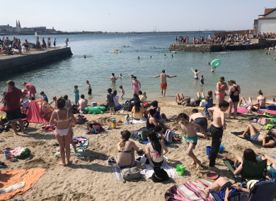 Crowds of people enjoying the sunny weather on the beach in Sandycove, Dublin in July 2018
