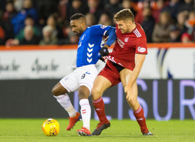 Tommie Hoban tangling with Jermain Defoe during Aberdeen's recent game against Rangers.