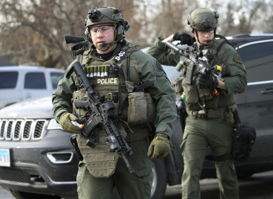 Police officers armed with rifles at the scene