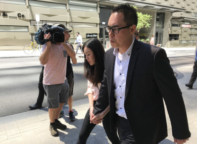 Andrew Doan (right) and fiance Wendy Wang leave the District Court of WA in Perth.