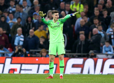 Kepa gestures to Sarri to say he wants to continue.