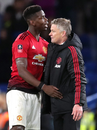 Paul Pogba and Ole Gunnar Solskjaer pictured after the Chelsea game.