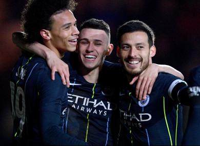 David Silva celebrates with Manchester City team-mates