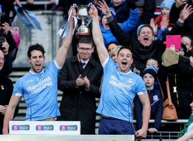 Gearoid McInerney and Niall Burke lift the trophy.