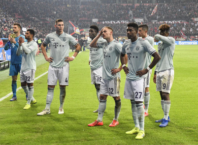 Disappointed Bayern players stand in front of their supporters after a shock defeat to Bayer Leverkusen.