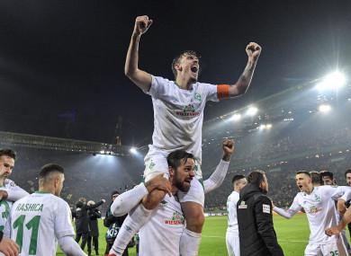 Bremen's Max Kruse, top, celebrates on the shoulders of goalscorer Martin Harnik.