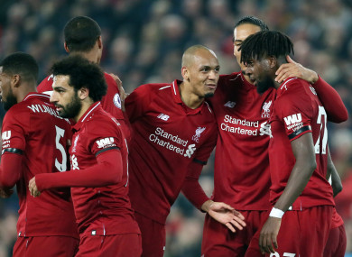 Liverpool celebrate their third goal.