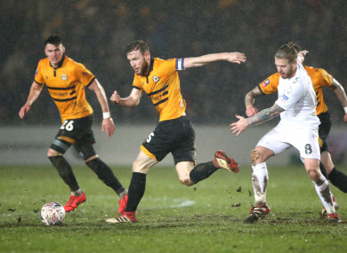 Middlesbrough's Adam Clayton (right) battles for the ball with Newport County's Mark O'Brien (second left).