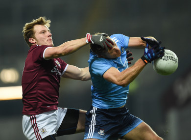 Gearoid Armstrong competes for a ball with Paul Flynn.