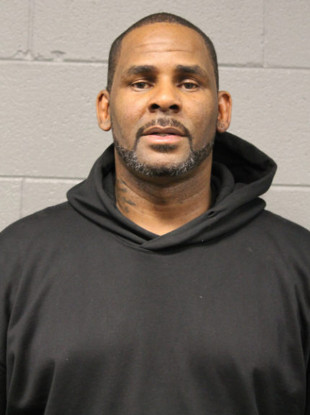 R Kelly photographed at a police station in Chicago