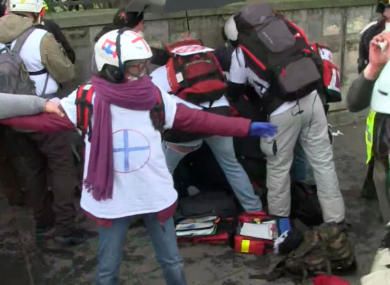 Emergency services helping the injured man in Paris today.