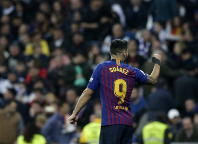 Luis Suarez celebrates Barca's third goal.
