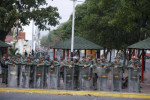 Bolivarian National Guard of Venezuela lineup to block the main entrance of Simon Bolivar bridge to San Antonio after being closed in San Antonio, Venezuela