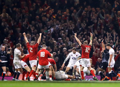 Wales celebrate Hill's try.