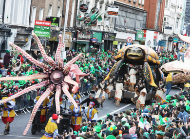 Floats pass through Dame Street in Dublin city centre today