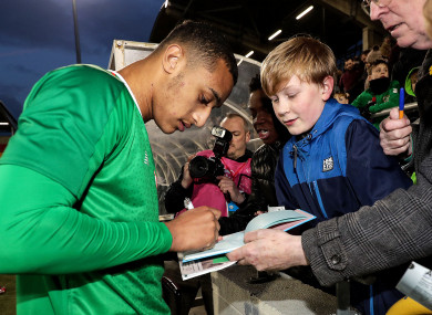 Idah signs autographs for supporters after full-time at Tallaght Stadium.