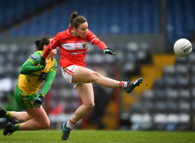 Cork's Melissa Duggan is tackled by Treasa Doherty of Donegal.