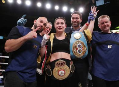 Katie Taylor celebrates a piece of Irish boxing history with her team.