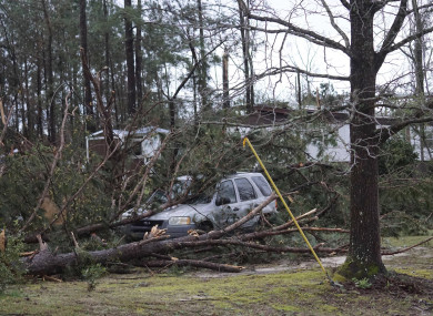 A vehicle is caught under trees in Beauregard, Alabama following a tornado on Sunday night.