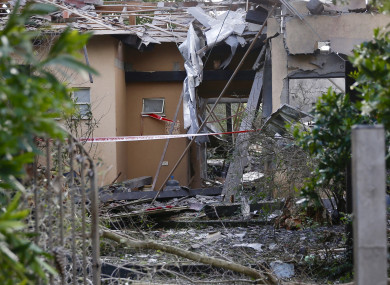 Damage to a house hit by a rocket in Mishmeret, central Israel