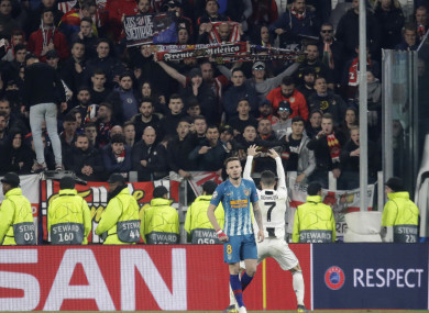 Ronaldo celebrates in front of Atletico fans.