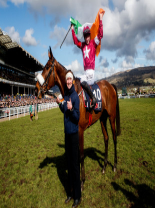 Sharples leads Jack Kennedy and Shattered Love back into the winner's enclosure at last year's Cheltenham Festival.