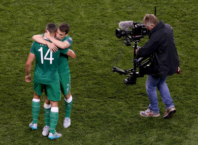 Jon Walters and Seamus Coleman embrace after a Euro 2016 qualifier against Georgia.