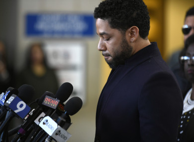 Jussie Smollett talks to the media before leaving Cook County Court after his charges were dropped on Tuesday