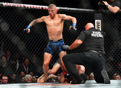 TJ Dillashaw celebrates after defeating Cody Garbrandt in November 2017 to regain the UFC bantamweight title.