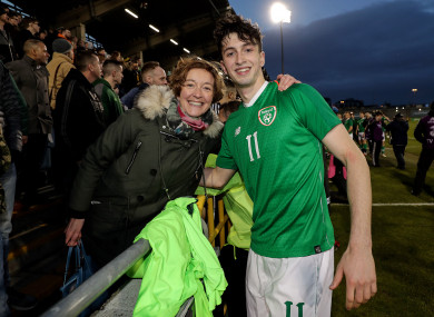 Ireland's Neil Farrugia celebrates with his mother, Mary Farugia, after the U21 game.