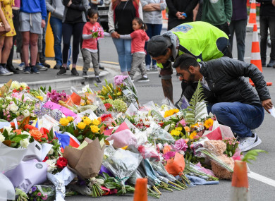 People place flowers to mourn the victims of the attacks on two mosques in Christchurch, New Zealand