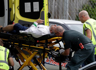 Ambulance staff take a man from outside a mosque in central Christchurch after the attack.