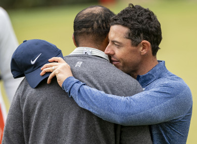 Tiger Woods embraces Rory McIlroy (right) on the 17th green.