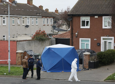 Gardai and Garda Forensics investigating a fatal shooting which occurred in the front garden of a house at Foxdene Avenue.
