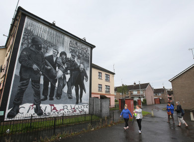 A mural in the Bogside area of Derry depicting Dr Edward Daly as he led injured civil rights protestor Jackie Duddy away from gunfire on Bloody Sunday.