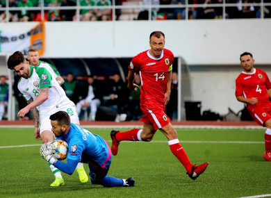 Sean Maguire clashes with Gibraltar 'keeper Kyle Goldwin.