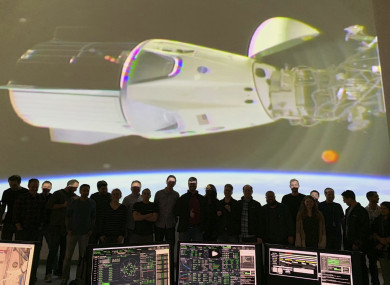 The SpaceX team in Hawthorne, California watches as the SpaceX Crew Dragon docks with the International Space Station's Harmony module.