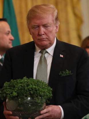 US President Donald Trump with a bowl of shamrock presented by Taoiseach Leo Varadkar at the White House on Thursday.
