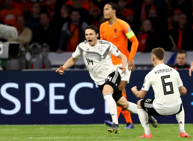 Nico Schulz celebrates his late winner.