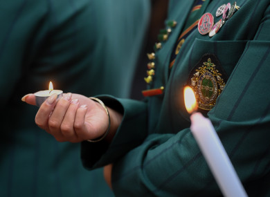 Students light candles to mourn victims during a mourning ceremony near the attack site in Christchurch.