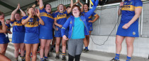 Tipperary celebrate their win with supporter Amy Lillis.